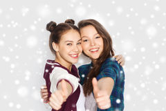 Happy smiling teenage girls showing thumbs up Stock Photo