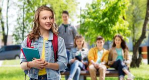 Happy smiling teenage student girl with school bag royalty free stock photos