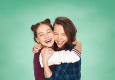 Happy smiling teenage student girls hugging Royalty Free Stock Images