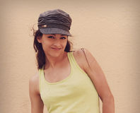 Happy smiling teenager in fashion cap posing Stock Photography