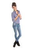 Happy smiling teenager in jeans isolated on white. Stock Photography