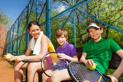 Happy smiling tennis players having rest after set Stock Photo