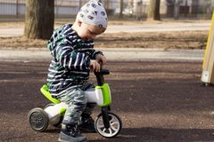 Happy smiling toddler boy riding bike. Kids enjoying a bicycle ride. Active toddler. Sport concept. Educational toys for. Preschool, kindergarten child. outdoor Stock Photos