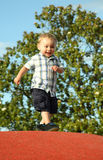 Happy smiling toddler walking Stock Images