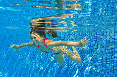 Happy smiling underwater child in swimming pool Royalty Free Stock Photography
