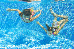 Happy smiling underwater children in swimming pool Royalty Free Stock Photography