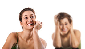 Happy smiling and a unhappy depressed woman Stock Image