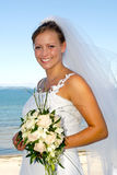 Happy smiling wedding bride with bouquet. Royalty Free Stock Images