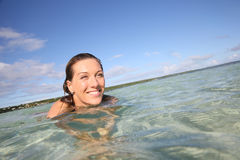 Happy smiling woman bathing in the sea Stock Images