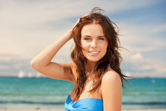 Happy smiling woman on the beach. Bright picture of happy smiling woman on the beach Stock Photo