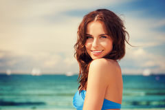 Happy smiling woman on the beach. Bright picture of happy smiling woman on the beach Royalty Free Stock Photography