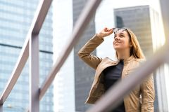 Happy smiling woman in big city with skyscrapers. royalty free stock photo