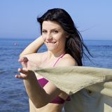 Happy smiling woman in bikini on the beach Stock Photo