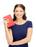 Happy and smiling woman with book Royalty Free Stock Images