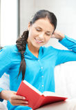 Happy and smiling woman with book Stock Image