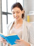 Happy and smiling woman with book Stock Photography