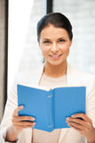 Happy and smiling woman with book Stock Images