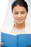 Happy and smiling woman with book Royalty Free Stock Photo