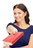 Happy and smiling woman with book Royalty Free Stock Photos
