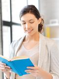 Happy and smiling woman with book Stock Photo