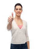 Happy smiling woman with braces showing thumbs up Stock Photo