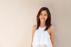 Happy smiling woman in casual dress, warm tone color Royalty Free Stock Photo
