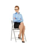Happy and smiling woman on a chair Stock Image