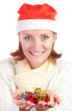 Happy smiling woman in christmas hat Royalty Free Stock Image
