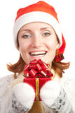 Happy smiling woman in christmas hat Stock Photo