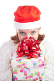 Happy smiling woman in christmas hat with gift Stock Photography