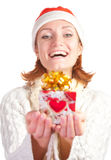 Happy smiling woman in christmas hat with gift Stock Images