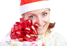 Happy smiling woman in christmas hat with gift Royalty Free Stock Photos