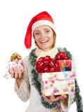Happy smiling woman in christmas hat with gifts Stock Photo