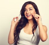 Happy smiling woman cleaning the teeth the dental floss. Dental Royalty Free Stock Images