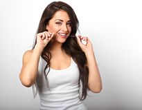 Happy smiling woman cleaning the teeth the dental floss on white Royalty Free Stock Images