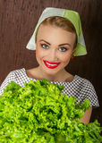 Happy smiling woman cook holding salad Stock Photo