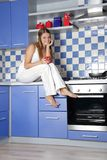 Happy smiling woman cooking on kitchen Stock Photography