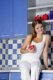 Happy smiling woman cooking on kitchen Royalty Free Stock Image