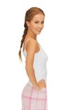 Happy and smiling woman in cotton pajamas stock photos