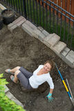 Happy smiling woman doing yard maintenance Stock Photos