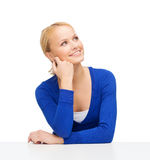 Happy smiling woman dreaming Royalty Free Stock Image