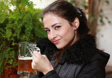 Happy smiling woman drinking lager beer. Royalty Free Stock Images