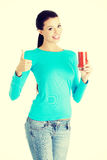 Happy smiling woman drinking tomato juice Stock Photography
