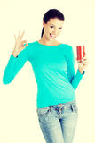 Happy smiling woman drinking tomato juice Royalty Free Stock Image