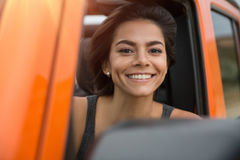 Happy smiling woman driving a jeep Stock Images