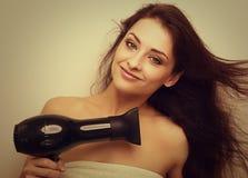Happy smiling woman drying long hair Royalty Free Stock Photos