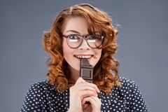Happy smiling woman eating chocolate Stock Photo