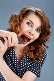 Happy smiling woman eating chocolate Royalty Free Stock Photos