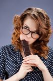 Happy smiling woman eating chocolate Stock Photos