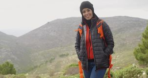 Happy smiling woman enjoying a misty hike stock video footage